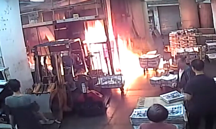 Masked Thugs Clad in Black Set Fire to the Epoch Times Printing Press in Hong Kong